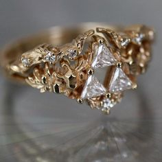 Goddesses' Relic Ring Conflict-free diamond engagement ring inspired by the Triforce from the Legend of Zelda: Ocarina of Time. Video game bridal jewelry made by Soulbound NYC. Classic Engagement Rings, Platinum Engagement Rings, Engagement Ring Settings, Nerdy Engagement Rings, Victorian Engagement Rings, Bridal Rings, Wedding Jewelry, Wedding Rings, Gold Wedding