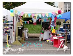"""fantastic booth set up, the signs, bunting, pom poms, tape """"rug"""" are all ideas I've been playing with and they did it masterfully"""