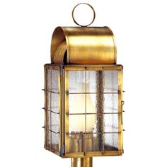 Newport Harbor Post Mount Copper Lantern by Lanternland. The Newport Harbor Post Mount Copper Lantern, shown here in our golden Antique Brass finish with Seeded Glass, is a classic nautical style copper lantern perfect for waterfront homes and damp locations such as a pier or dock. Made by hand in America from high quality copper or brass the Newport Harbor Post Mount Copper Lantern will never rust or corrode and includes our lifetime warranty.