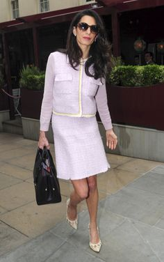 In a pastel Giambattista Valli tweed suit after attending a business meeting in London.   - ELLE.com