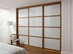 wood effect white glass built in wardrobe sliding doors