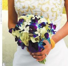 blue and purple wedding bouquets | stephanotis and purple dendrobium orchids that have been dyed blue