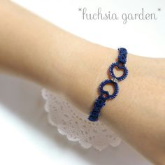 A really really easy to tat bracelet. One can add two beads in the rings as well. Tatted bracelet // Tatting for beginners // Blue Bracelet Tatting Bracelet, Tatting Patterns, Knit Mittens, Beaded Rings, Crochet Stitches, Beads, Knitting, Bracelets, Earrings