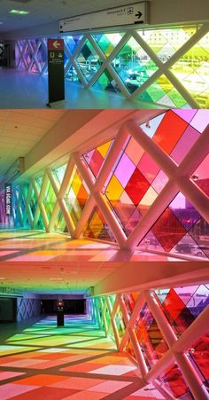 Rainbow hallway -  the work of american sound architect christopher janney, 'harmonic convergence' is an interactive sound and light installation,  constructed within the pedestrian walkway of the Miami international airport in Florida.