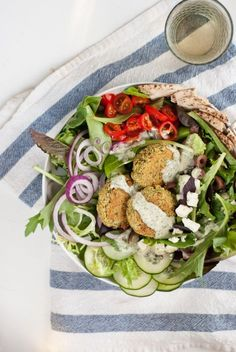 Crispy, low fat baked falafel is so easy to make and tastes incredible! I serve mine on a Greek salad. The falafel happens to be vegan and gluten free.