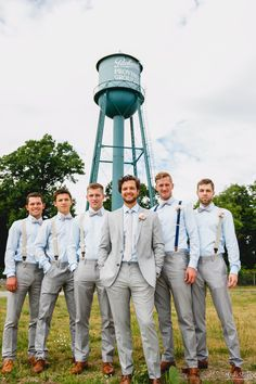 Groomsmen in grey suits stand in front of watertower #Michiganwedding #Chicagowedding #MikeStaffProductions #wedding #reception #weddingphotography #weddingdj #weddingvideography #wedding #photos #wedding #pictures #ideas #planning #DJ #photography #pre-ceremony #groom