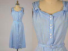 Vintage 1950s light blue and white gingham sun dress of midweight cotton. Sleeveless with button tab at shoulders. White pearly plastic button closure