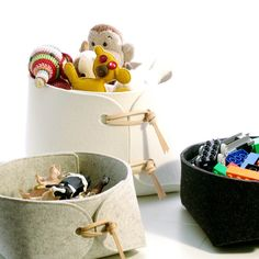 Toy storage bins with natural leather details by SKANDINAVIOUS