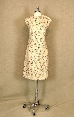 LOVE  Vintage 1960s Dress / Cream Linen Dress with Birds. $68.00, via Etsy.