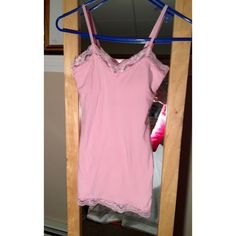 """visit poshmark and sign up free and use code PZTND for a $5 credit! Selling this """"Pink Tank with built in Bra"""" in my Poshmark closet! My username is: mariellelauren. #shopmycloset #poshmark #fashion #shopping #style #forsale #No Boundaries #Tops  poshmark.com/closet/mariellelauren"""