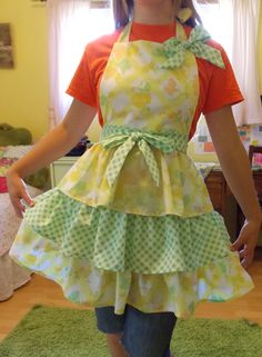 Hand sewn triple tiered apron made from vintage sheets by content 2B sew. Sold at Arnes Farmers Market summer 2014.
