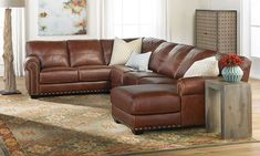 Room size sectional with chaise end crafted in Italy and completely upholstered in the finest hides with hand applied nail head trim.