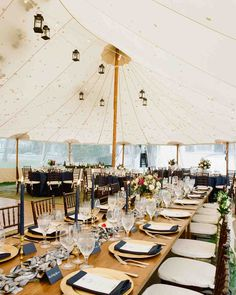 Hanging Lanterns and Lights | Martha Stewart Weddings - For Lindsay and Garrett's Martha's Vineyard reception, Big Sky Tents set up a sailcloth canopy over the patio of the Dr. Daniel Fisher House and lit it with a combination of lanterns and bistro lights.