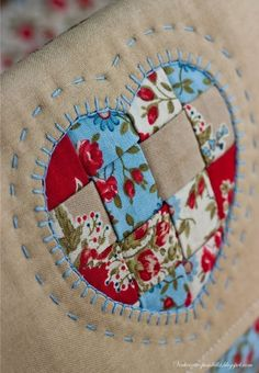 REVERSE APPLICATE WITH DECORATIVE  LARGE STRAIGHT STITCH EMBROIDERY  EMBELLISHMENTS.  7/17 JS