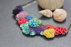 A Rainbow Corals Necklace. Each coral was carved by hand and it took several hours to sculpt this necklace. It is impossible to replicate, so each coral piece is one of a kind.