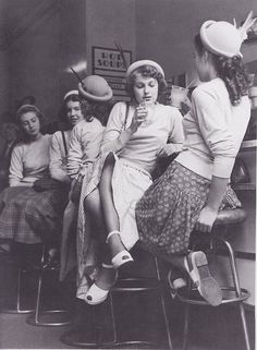 1950s teenagers at the soda shop