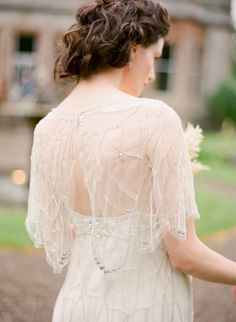 Chic in a capelet: http://www.stylemepretty.com/2015/09/01/make-a-statement-with-bold-bridal-accessories/