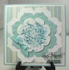 handmade greetin card ... layers of Floral Framelits with dahlia stamped on top ... Pool Party and Island Indigo ... like the little bow ... extra depth from embossing folder texture on one layer ... great card ... Stampin' Up! by bethany