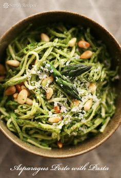 Fresh spring asparagus pesto recipe with baby spinach, asparagus, pine nuts, olive oil and garlic, served with fettuccine pasta. On SimplyRecipes.com