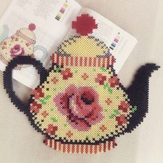 Kitchen teapot cross stitch.
