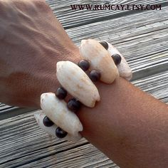 Sea Shells and wood beads bracelet  by Rum Cay Island Jewelry