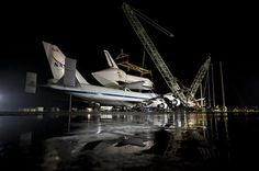 In this image provided by NASA the NASA 747 Shuttle Carrier Aircraft with the space shuttle Discovery mated on top rolls into position for demating at Washington Dulles International Airport, Wednesday, April 17, 2012, in Sterling, VA. Discovery, the first orbiter retired from NASA's shuttle fleet, completed 39 missions, spent 365 days in space, orbited the Earth 5,830 times, and traveled 148,221,675 miles. NASA will transfer Discovery to the National Air and Space Museum to begin its new…