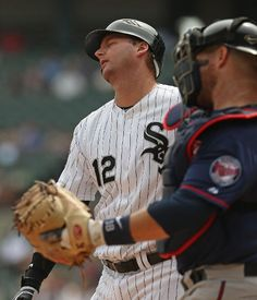 A.J. Pierzynski #12 of the Chicago White Sox reacts after striking out as Ryan Doumit #18 of the Minnesota Twins throws the ball back to the pitcher at U.S. Cellular Field on September 5, 2012 in Chicago, Illinois.