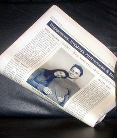 """Monica and """"Chandler"""" 's engagement photo in the papers. Joey did the shot instead of Chandler because Chandler can't smile in front of the camera!"""