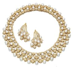 CULTURED PEARL AND DIAMOND DEMI-PARURE Comprising: a necklace of bib design, set with cultured pearls, accented with falling star motifs, set with brilliant-cut diamonds, length approximately 390mm, detachable section length approximately 20mm; and a pair of ear clips.