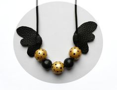 Flying necklace. Air dry clay necklace with wings. by Scarfonaut