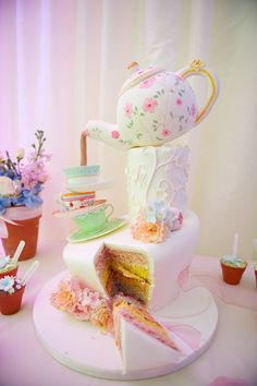Maybe with the hat for the small cake and a tablecloth on the base tier like a table?