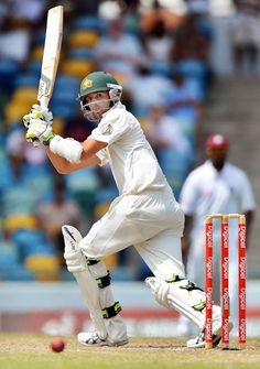 Australian cricketer Nathan Lyon plays a shot off West Indies bowlerFidel Edwards during the fourth day of the first-of-three Test matches between Australia and West Indies at the Kensington Oval stadium in Bridgetown on April 10, 2012.