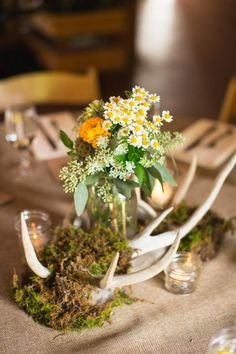 Ranunculus chamomile and seeded eucalyptus centerpieces
