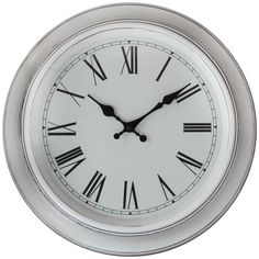 White Washed Antique Round Wall Clock - White A beautiful antique style white wall clock With a glossy deep metal casing, Roman numeral printed dial and sleek glass lens This clock is stylish and attractive an