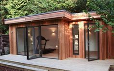 You can use your garden office like a gym room or even a music room it depends on your style. A garden office is not really an office but it has many purpose. Gym Shed, Shed Office, Garden Office, Backyard Studio, Garden Studio, Backyard Gym, Backyard Retreat, Outdoor Office, Outdoor Living