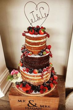 """Naked wedding cakes 6"""", 8"""", 10"""" tiers decorated with summer berries and a lovely bespoke cake topper"""