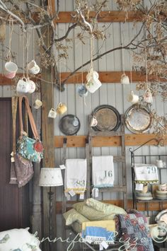 Seven secrets to merchandising,styling and display for a show or market… or your home! Love the use of tree branches to display pretty cups and clothes : ) Antique Booth Displays, Antique Booth Ideas, Vintage Display, Vintage Store Displays, Antique Mall Booth, Deco Cafe, Flea Market Booth, Flea Market Displays, Craft Show Displays