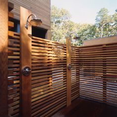 12 Outdoor Showers: New York City-based firmResolution: 4 Architectureuses Japanese-style wood slats to enclose a double shower on a deck.