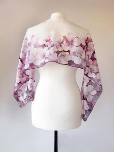 Cherry Blossom scarves is a slim hand painted silk scarf with floral pattern of sakura blooming. This is a perfect 4th anniversary gift and a great gift for mother. The Cherry Blossom scarf is painted with set of dark and bright pink shades and a bit brown tones. It has a very sublime color