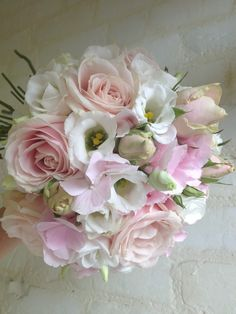 bridal bouquet of pale pink roses, hydrangea and white eustoma