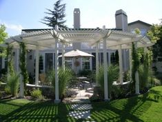 The slats of this circular arbor span outward like the framework of an open fan…