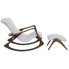 Contour rocking chair and ottoman by Vladimir Kagan    1950s  One of Vladamir Kagan's dynamic sculptural designs, the contour rocking chair is as visually compelling as it is comfortable. The large chair with sweeping walnut frame cradles an upholstered seat. The accompanying ottoman maximizes the relaxation this great chair offers.  Price  $14,000