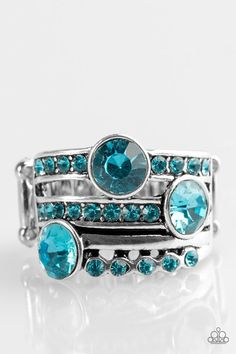 Shimmery blue rhinestones are sporadically sprinkled across layered silver bands, creating a show-stopping shimmer. Features a stretchy band for a flexible fit.  Sold as one individual ring.  New Kit P4RE-BLXX-103XX