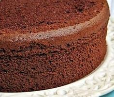 Chocolate chiffon cake is a light and spongy cake. Goes well with a heavy chocolate ganaché coating. Line bottom only of cake pan with parchment paper cut to fit. Food Cakes, Cupcake Cakes, Chocolate Chiffon Cake, Chocolate Sponge Cake, Sponge Cake Recipes, Cake Plates, Vegetarian Chocolate, Vanilla Cake, Clean Eating Sweets