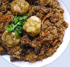 Try this recipe for Plov from Uzbekistan, best described at risotto meets lamb stew - a festive dish of tender lamb, rice, carrots, onions and spices.