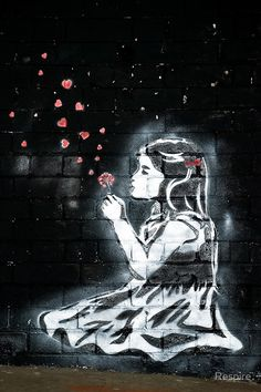 Girl blowing hearts by Banksy