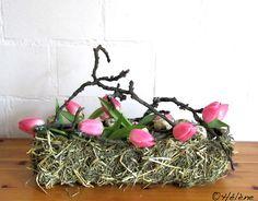 Tulpen und Heuhülle