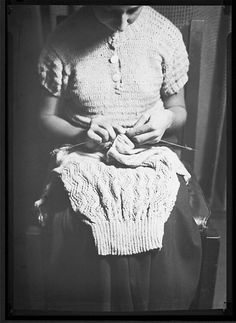 lewis w hine - woman knitting sweater - 1920