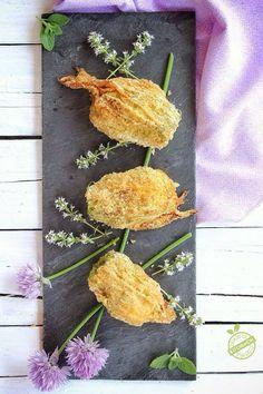 Fiori di zucca ripieni di riso e zucchine
