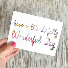 A beautiful papercut greeting card to wish a special someone a wonderfully wonderful day. Perfect for Birthdays or to quite simply brighten someones day!Through the paper cut lettering, you get a glimpse of the gorgeous watercolour print. The print is a mix of hand painted tropical flowers and leaves in bold & bright co-ordinating colours. Once the occasion is over and it's time to take down the cards, you don't throw this card away, oh no! These cards have been designed to become a trea...